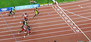 Jamaica at the 2008 Summer Olympics - The participants in the men's 100 meters. Usain Bolt demonstrates a clear lead. Asafa Powell and Michael Frater are also visible.