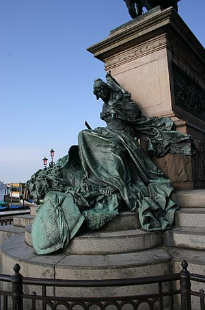 Republic of San Marco - The 1887 bronze equestrian monument to Victor Emmanuel II in Venice, modelled by Ettore Ferrari (1848–1929), stands on the Riva degli Schiavoni. The details shows Venice in chains after the defeat in the 1848–49 Revolution. At her side, the Lion of Saint Mark in chains.