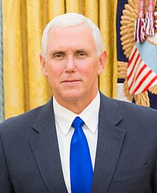Mike Pence, in a suit and royal-blue tie