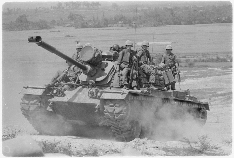 Vietnam. Marines of E Company, 2nd Battalion, 3rd Marines, riding on an M-48 tank. - NARA - 532441