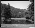 View of pond at the horse ranch, facing west - The Horse Ranch, Eagle Cap Wilderness Area, Joseph, Wallowa County, OR HABS ORE,32-JOS.V,1-7.tif