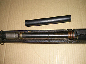 Vz. 52 rifle - Vz. 52 with handguard removed to show the gas system. The nut closer to sling bracket is the adjusting nut locknut. Between the gas piston (lighter colour) and the locknut is the adjusting nut itself. Operating rod removed and placed on the right side.