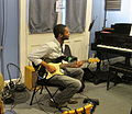 WWOZ Tank and the Bangas Guitar.JPG