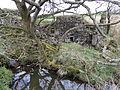 Waterland Mill - waterwheel wall and lade.JPG