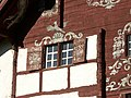 Werdenberg. Schlangenhaus. Facade paintings. Row 4. Left window - 001.jpg