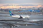 WestJet Boeing 737-700 C-FWSK (4506495993) (2).jpg