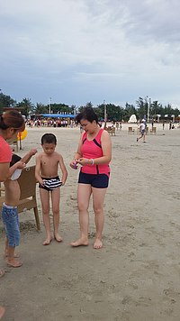 Woman wearing body-skin swimsuit in Beihai Silver Beach.jpg