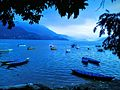 Wooden boats scattered on Phewa lake.jpg