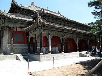 Xiantong Temple - The large Mahavira Hall, dedicated to Shakyamuni, is roofed with multiple eaves; a long porch spreads along the front.