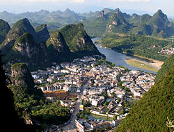 The town of Yangshuo from a nearby karst peak known as the TV tower. The Li River can be seen in the background.