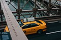 Yellow taxi cab from above (Unsplash).jpg