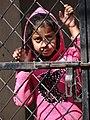 Young Girl at Gate - Darjeeling - West Bengal - India (12406451294).jpg