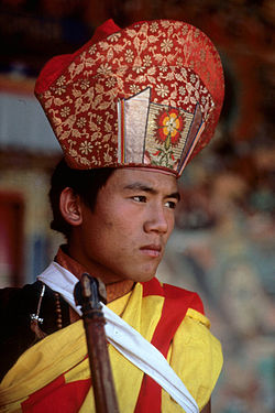 Young monk, wearing a special costume, Desert road in China, July-August 1991, Sikkim, India.jpg