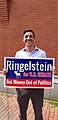 Zak Ringelstein in Portland, Maine holding one of his yard signs.jpg