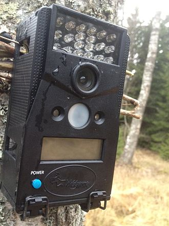Remote camera - Remote camera. Top shows several LED flash lights, centre are the lens and PIR sensors.