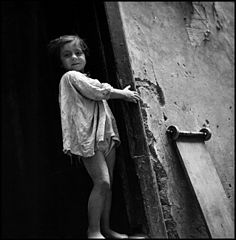 """Children In Naples, Italy"". Little girl. Photographed by Lieutenant Wayne Miller, July 1944. U.S. Navy Photograph, now in the collections of the National Archives.jpg"