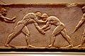 02 2020 Grecia photo Paolo Villa FO190082 bis (Museo archeologico di Atene) Base per la statua di un Kouros atleta funerario in marmo pentelico (dettaglio solo fronte parte centrale) NAMA 3476 Circa 510 a.C., con gimp.jpg
