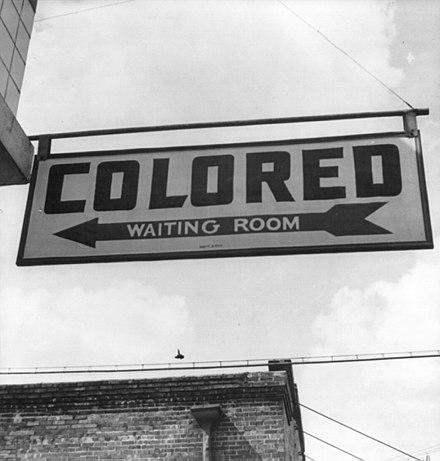 "Sign for ""colored"" waiting room at a Greyhound bus terminal in Rome, Georgia, 1943 (Wikipedia, ""Racial segregation in the United States"")."