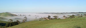 Hills of South Gippsland in Victoria, Australia, partly shrouded in morning mist