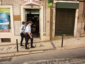 Crime in Portugal - Portuguese police walk a street in Lisbon.
