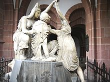 Neoclassical tomb of Friedrich Karl Joseph von Erthal at Aschaffenburg, showing him allegorically as a dying hero of antiquity (Source: Wikimedia)