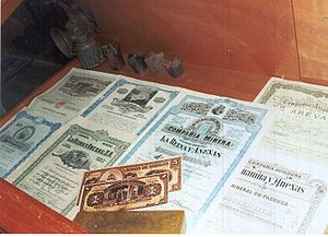 English: Stock certificates and money printed ...