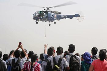 A Chetak helicopter carrying out a live demonstration for an audience of differently abled children at INS Shikra.jpg