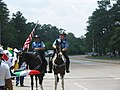 A Day Without Immigrants - two horse-mounted police officers.jpg