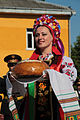 A Ukrainian dancer presents bread, a traditional symbol of hospitality, to assembled multinational troops during the opening ceremony for exercise Rapid Trident 2013 in Yavoriv, Ukraine, July 8, 2013 130708-O-ZZ999-004-UA.jpg