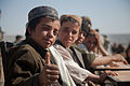 A boy in the Ananzai village of Kandahar province, Afghanistan, gives a thumbs-up during an opening celebration Dec. 26, 2011, for the village's new school, which he will attend 111226-A-VB845-095.jpg