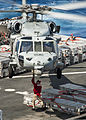 A crew member aboard the dry cargo and ammunition ship USNS Richard E. Byrd (T-AKE 4) attaches a cargo hook to an MH-60S Seahawk helicopter assigned to Helicopter Sea Combat Squadron (HSC) 6 during a weapons 130428-N-LP801-155.jpg