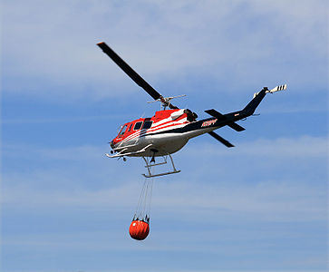 A fire helicopter with helicopter bucket