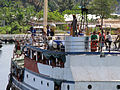 A fully packed boat transports passengers to Auki, the capital of Malaita. (10662105363).jpg