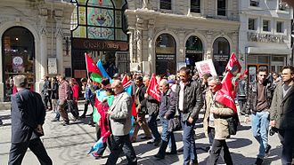 """100th anniversary of the Armenian Genocide - Protest against the so-called """"genocide allegations"""" in the Istiklal Avenue on the 100th anniversary: With Azerbaijani flags and the banner: """"America is the problem"""""""
