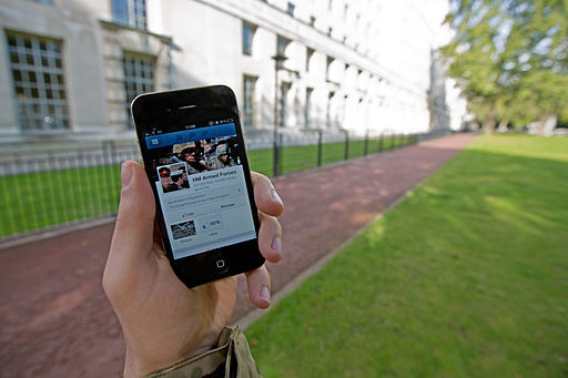 A serviceman accesses social media channels using a smart phone, outside MOD Main Building in London MOD 45156045