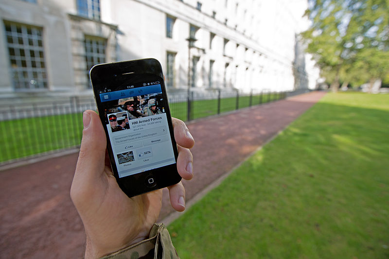 File:A serviceman accesses social media channels using a smart phone, outside MOD Main Building in London MOD 45156045.jpg