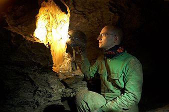 A speleologist highlights a gypsum crystal.jpg