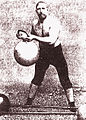 A turkish wrestler lifts girya.jpg