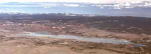 Cerro Pedernal - View from summit in winter, looking north. Abiquiu Lake in foreground; Tusas Mountains on horizon