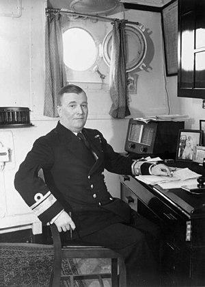 HMS Belfast (C35) - Admiral Burnett in his cabin aboard HMS Belfast.