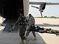 Afghan National Army and U.S. medics load patients onto the C-27 Spartan at Mazar-e-Sharif.jpg