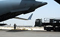 Air Transportation Airmen From the 380th Expeditionary Logistics Readiness Squadron's Air Terminal Operations Center Drives a 60,000-pound-capable Aircraft Loader to Unload a Plane During Operations DVIDS290901.jpg