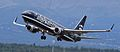 Alaska Airlines 737 in unique colors lifting off from ANC (IMG 1395a) (6334752505).jpg