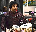 Amit Kavthekar performs tabla in concert.jpg