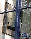 foto van Dubbel huis met gevel onder rechte zandstenen lijst met consoles en wapenschilden