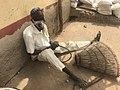 An elderly man weaving a basket.jpg