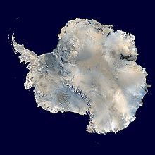 Satellite photograph of a large white ice cap in a dark blue ocean