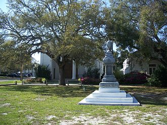 Apalachicola, Florida - John Gorrie Monument, located in Gorrie Square, with Trinity Episcopal Church in the background
