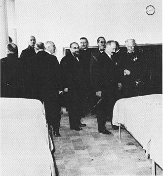 "Cité de Refuge - Albin Peyron (at left) with the President of the République Albert Lebrun (2nd left) and the architect Le Corbusier (3rd right) in 1933 during the inauguration of ""la Cité de refuge"" at 12 rue Cantagrel, Paris"