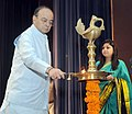 Arun Jaitley lighting the lamp at the National Academy of Customs, Indirect Taxes and Narcotics (NACIN) Foundation Day and Passing Out Ceremony of 67th Batch of IRS (C&CE), in Faridabad, Haryana.jpg